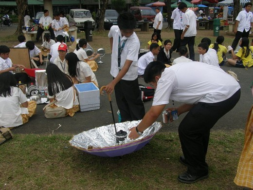 Students experimenting on a solar cooker using an umbrella