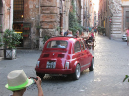 Our son photographs a car in Navona