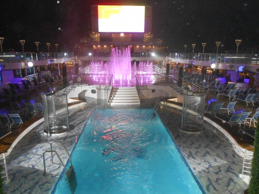 Enjoying a water show on The Royal Princess Cruise ship while earning money on Hub Pages!