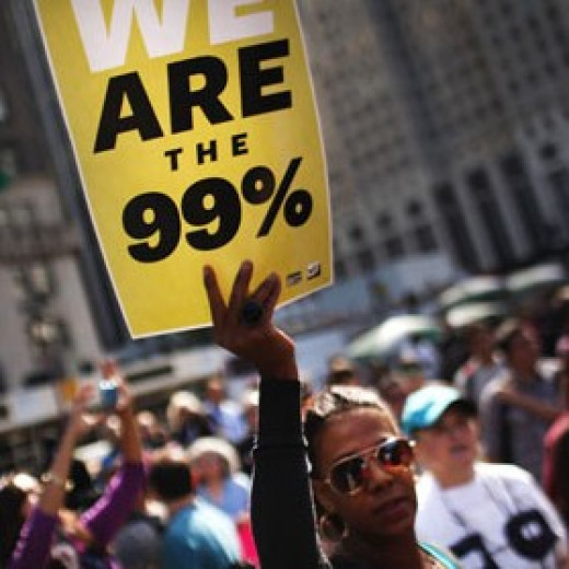A photo taken of protestors at an occupy wall street event.