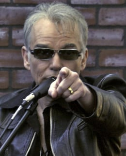 Billy Bob Thornton points at the camera.