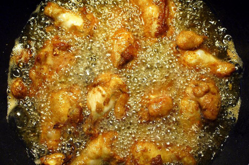 Chicken frying in corn oil