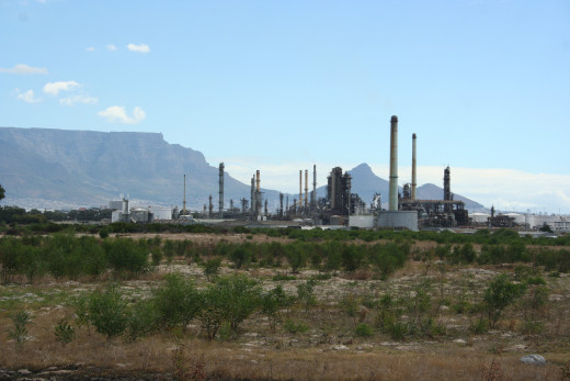 Chevron Oil Refinery (previously known as the Caltex Refinery) in Cape Town, South Africa. Table Mountain is pictured in the distant background.