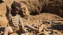 A young girl breaking-up rocks