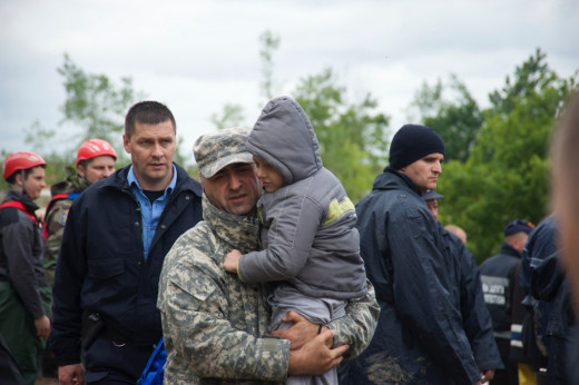 Soldier rescues a child in Obrenovac, Serbia