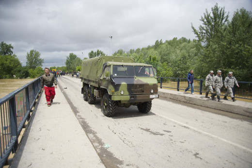 Military trucks are helping in the evacuation in Obrenovac, Serbia