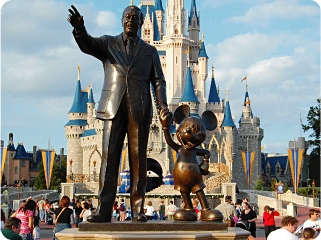 Walt Disney and Mickey Mouse immortalized in front of Cinderella's Castle in Magic Kingdom.