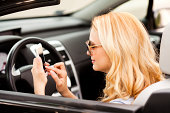 She is texting while driving.