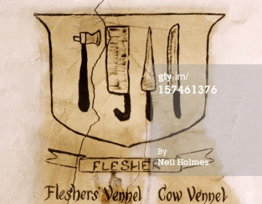 The crest of a Scottish artisans guild. The crests of nobility often displayed symbolic images; but guild crests displayed the tools craftsman members worked with. Compare this to the crossed hammer or wrenches of a modern trade union.