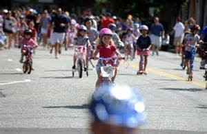 Riding bikes behind Fire Truck in the Memorial Day Parade