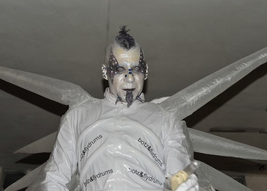 Man in white devil costume