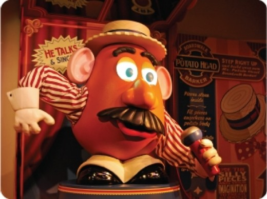 Mr. Potato Head serves as a carnival barker of sorts inside the Toy Story Mania! queue, personally interacting with guests as they wait and walk by on their way to boarding the attraction.