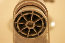 A tub faucet with built-up calcification from hard water
