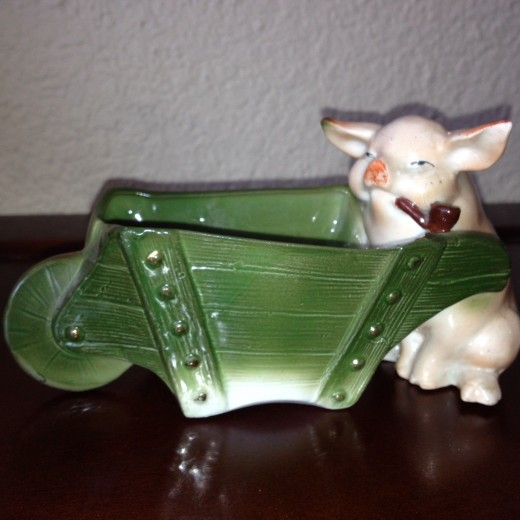 This pig pushing a wheelbarrow and smoking a pipe sold on ebay for $75. Rare.