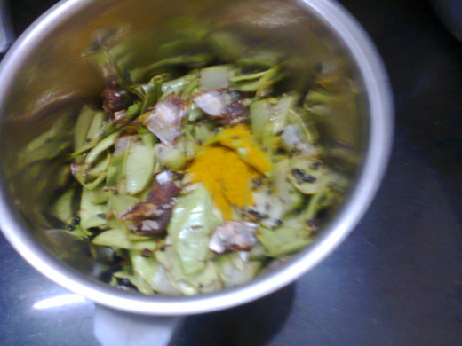 bottle gourd chutney ingredients put into grinding jar after frying