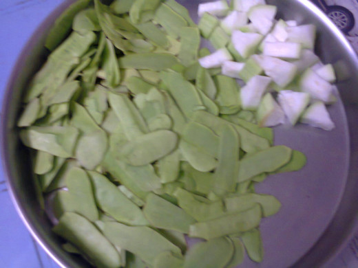 peeled skins of bottle gourd and some pieces of inner vegetable