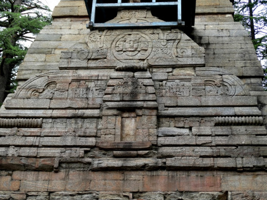 Stone carvings on the front facade of Dandeswar temple