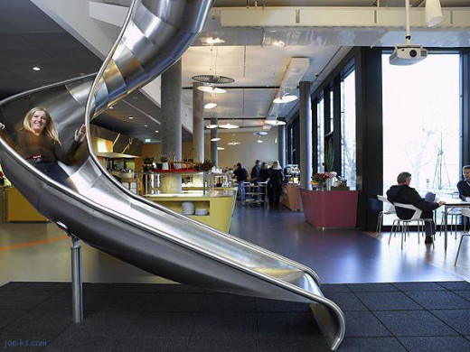 "At Google, employees can access the dining room by a slide.  Photo Credit: joe-ks.com (#1 humor site on the ""net."")"