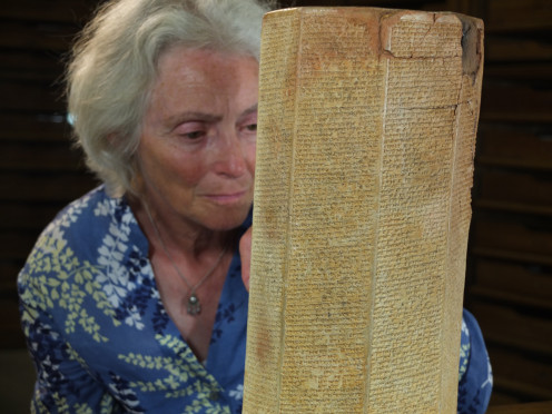 Dr. Stephanie Dalley studies cuneiform tablet from Nineveh