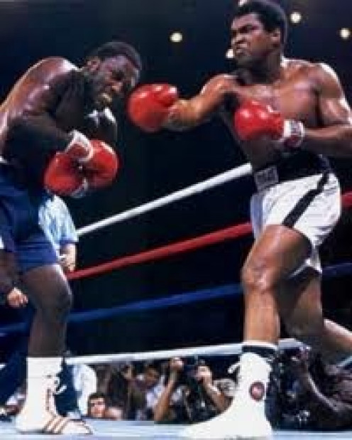 Muhammad Ali knocked out Smokin Joe Frazier in the 14th round of their rubber match.