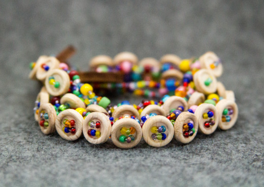 The wooden buttons keep these bracelets from getting overwhelming or too busy.