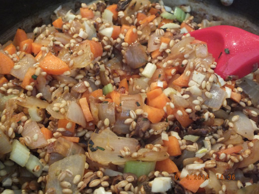 At this point you want to add the veggies, mushrooms, and barley-- saute this mixture a few more minutes.