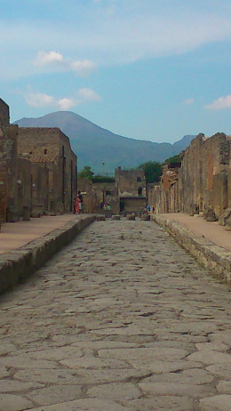 The streets of Pompeii with Vesuvius in the background
