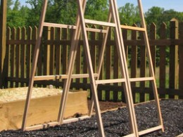 Here we have a frame built over a container that would be perfect for growing cucumbers.