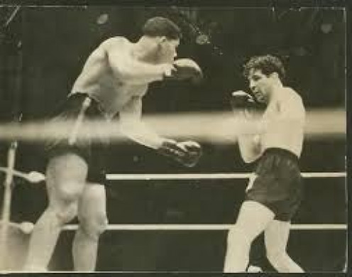 Joe Louis knocked out Max Baer as an upcoming contender on his way to the  championship.
