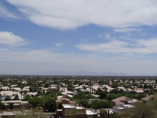 Phoenix Az is similar to LA being surrounded by mountains.  Looking to the south on a clear day the mountains are clearly visible. On an average day (pictured) the mountain views are obstructed and a bad day they disappear.