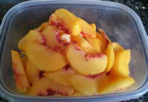 Peaches, sliced and peeled, ready for baking.