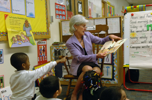 HHS Secretary Kathleen Sebelius visited the Judy Hoyer Early Learning Center at Cool Springs Elementary School in Adelphi, Maryland. Sebelius reads to a group of 4-year old Head Start students. HHS photo by Chris Smith