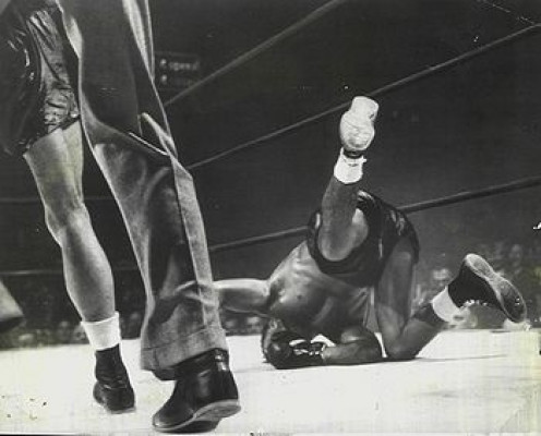 Homicide Hank put Fritzie Zivic down hard on his face in their first encounter.