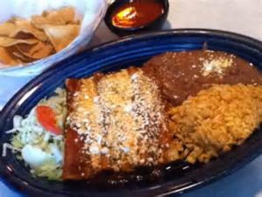 Enchiladas. rice, and beans