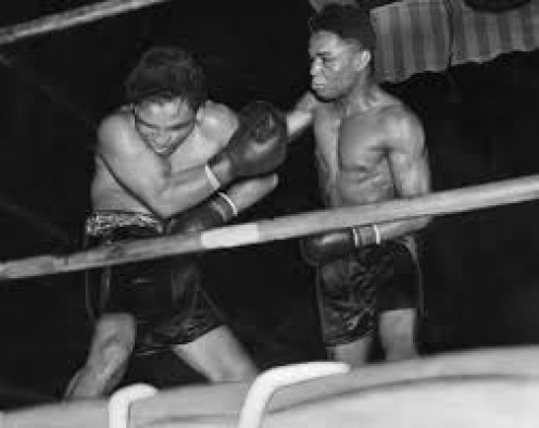 Henry Armstrong beat Baby Arizmendi by decision in defense of his welterweight championship.