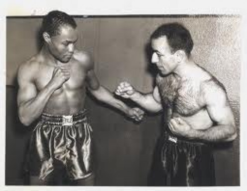 Henry Armstrong and Petey Sarron pose before their featherweight title fight in which Armstrong won to become the featherweight champion.