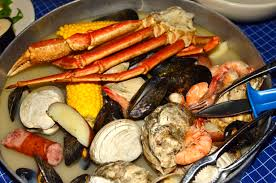 Shrimp, mussels, clams, oysters, snow crab legs, sausage, potatoes, and corn