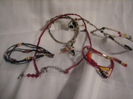 beads strung on colorful hemp thread, are sure to produce sturdy necklaces, bracelets and ankle adornments