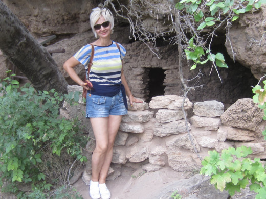 My wife next to Sinagua structure at nearby Montezuma Well