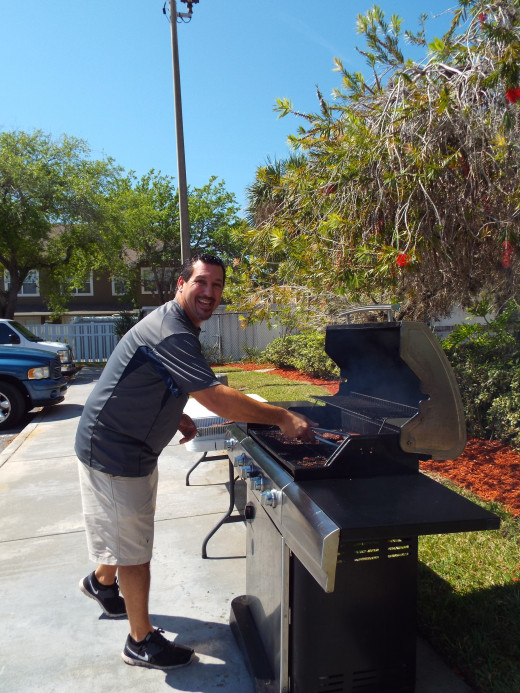 Pastor Marshick serving his community by cooking lunch for the volunteers & the homeless