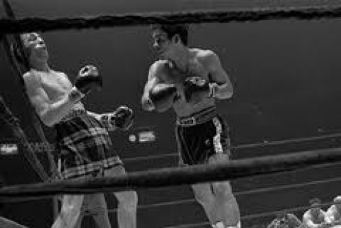 Roberto Duran scored a late rounds knockout  of Ken Buchanon to win the lightweight championship of the world.