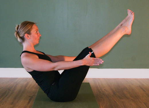 Boat pose is good for toning the abdomen