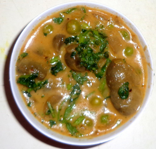 Coriander leaves are added on the Mutter Mushroom Curry or Green peas Mushroom curry for garnishing