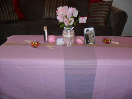 Mason jars, tablecloth, flowers, etc.