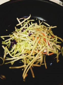 A version of Broccoli Slaw. Without the dressing, it is in a frying pan, waiting to be tossed with scrambled eggs or rolled into a omelet.