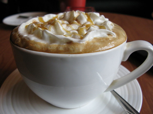 Coffee comes in many varieties. Try Latte with cream and caramel topping.