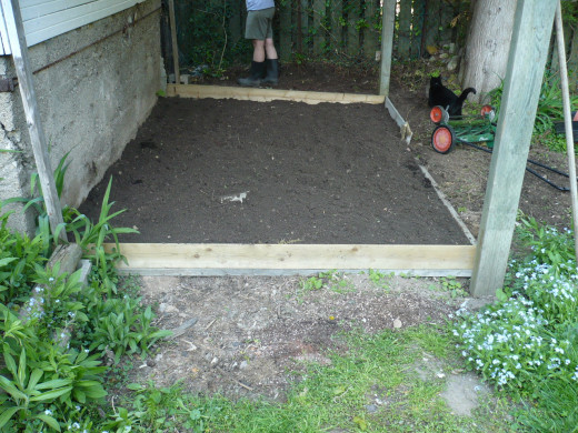 Fill to the top with topsoil and begin planting your vegetable plants.