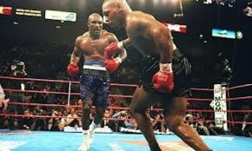 Evander Holyfield became a three time heavyweight champion by knocking out Iron Mike Tyson in 11 rounds in their first bout in 1996.