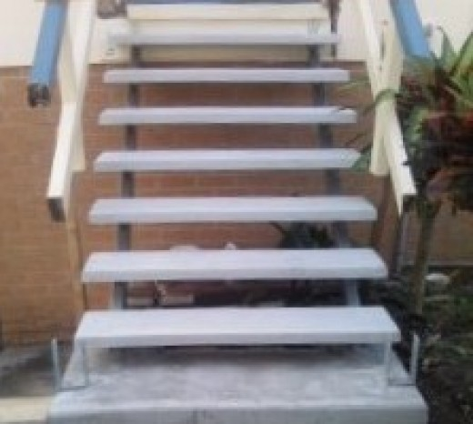 The older timber stairs have been removed  and we have replaced them with concrete treads.