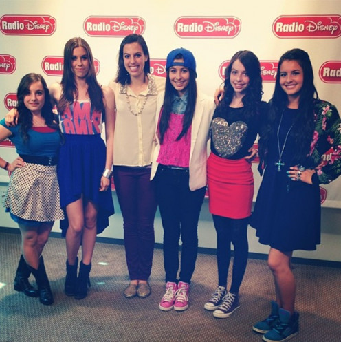 Cimorelli posing for a media picture.